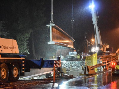 Girder being installed for new Montroyal bridge