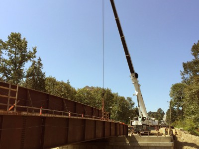 Photo of crane installing girders for second half of new Keith Road bridge