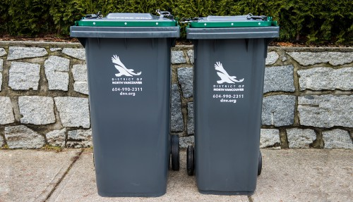 Picture of new 140L and 240L garbage and organics carts with wheels and locking lids