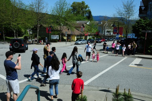 Families on the street in Deep Cove