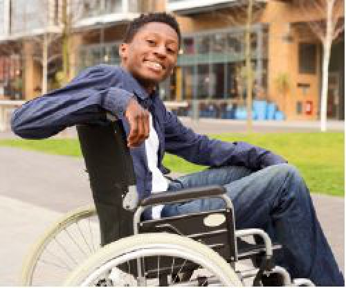 Smiling young man in a wheelchair