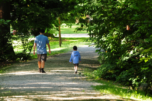 Man and child walking along a trail in Bridgman Park