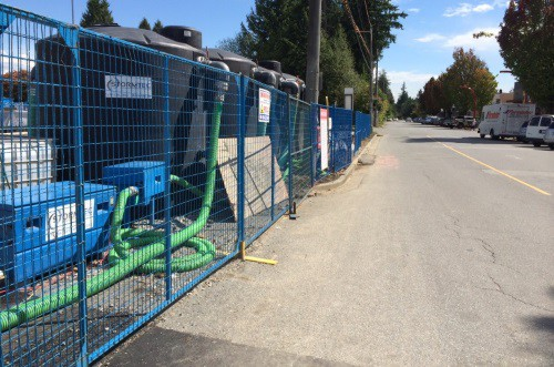 A construction site surrounded by blue fencing
