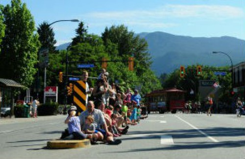 Crowd watching a parade in Lynn Valley
