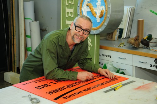 A staff member from the sign making department