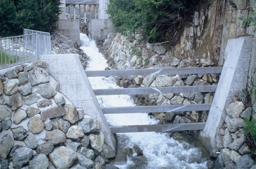 A gate added to a creek to prevent debris flow