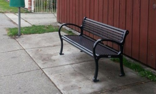 A bench at a bus stop