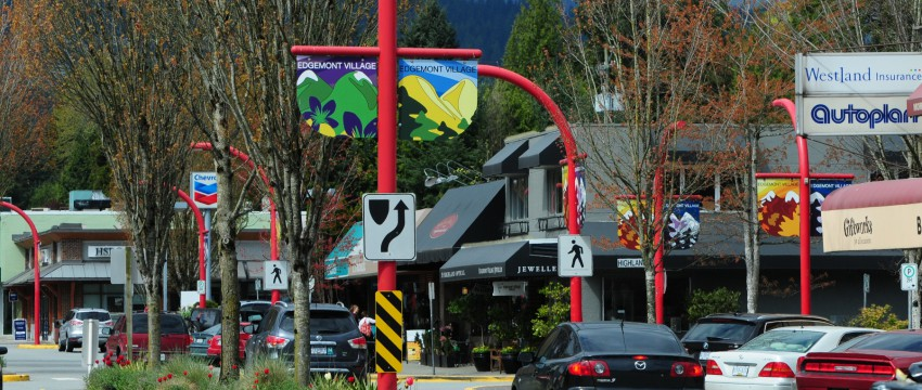 Cars driving through the centre of Edgemont Village