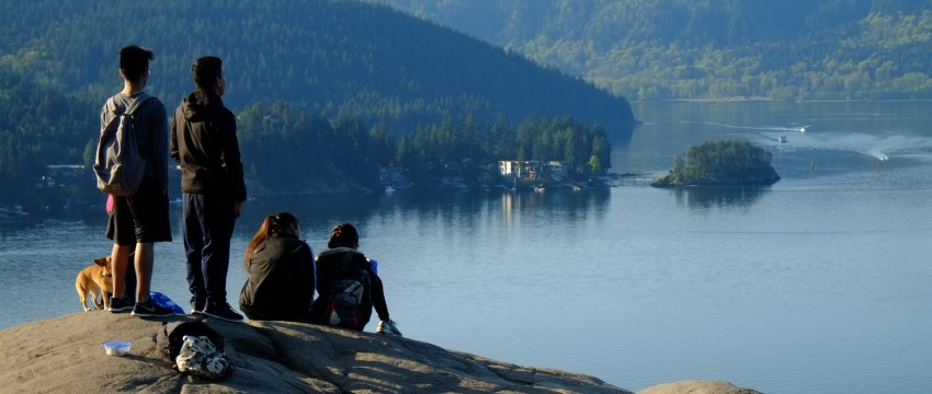 Hikers at the top of Quarry Rock in Deep Cove